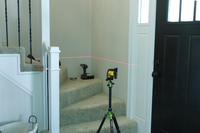 Dewalt Laser Level projecting laser beam across stairwell