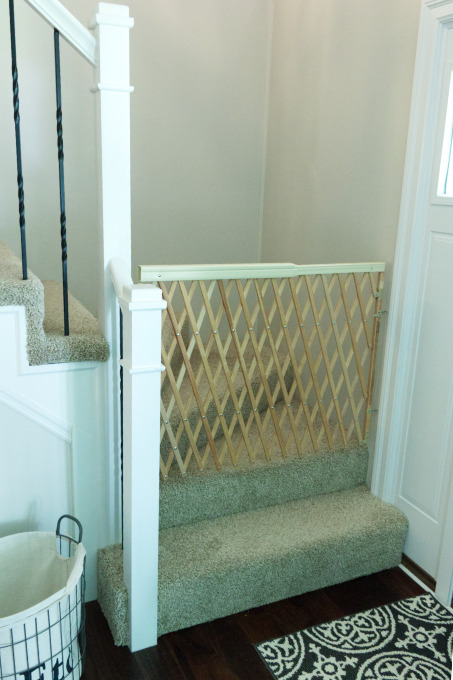 Baby gate hung on stairs for safety