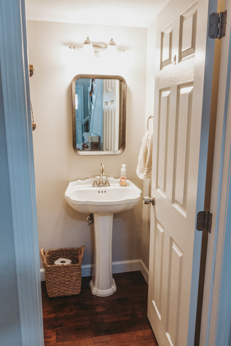 Half bathroom makeover shelving vintage industrial farmhouse decor plants modern vintage print on industrial shelf black wood mirror