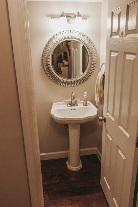 Half bathroom makeover shelving vintage industrial farmhouse decor plants modern glam metal mirror before