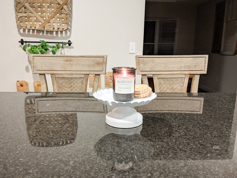 Cushioned bar stool pair behind kitchen island countertop